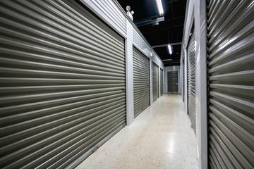 Long storage facility corrodor. Garage doors with light