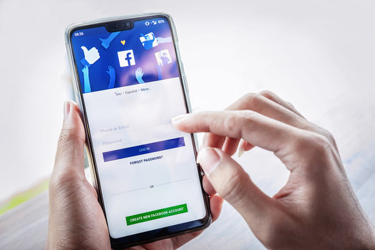 Chiangmai, THAILAND - July 7, 2018: Facebook social media app logo on log-in, sign-up registration page on mobile app screen on Oneplus 6 in person's hand working on e-commerce shopping business