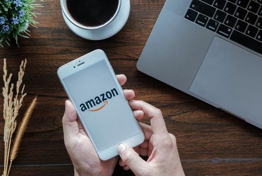 CHIANG MAI,THAILAND - January 20, 2019 : iPhone 6s showing Amazon logo to shopping online. Amazon.com, Inc. American international electronic commerce company.