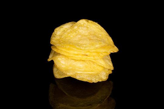 Lot of whole light crisp potato chip isolated on black glass