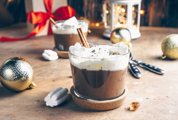 Foto auf Acrylglas Schokolade Hot chocolate with whipped cream and marshmallows in a glass mugs on festive background. Selective focus