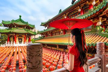 Wall Mural - Asian woman in chinese dress traditional at Sanfeng Temple in Kaohsiung, Taiwan.