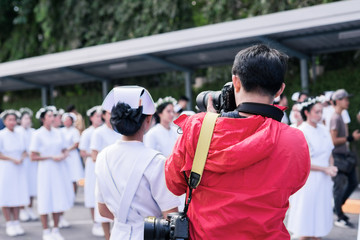 photographers taking pictures of nurses graduating