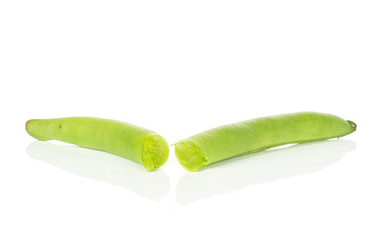 Group of two halves of bright snap green bean isolated on white background