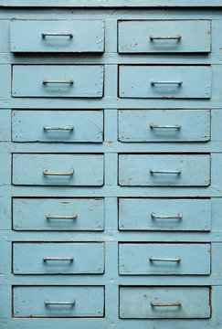 Old blue wooden closet with drawers