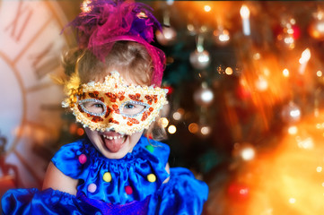 Foto op Canvas Carnaval Portrait of funny laughing 4 years old girl in carnival venetian mask. Christmas tree, big clock on background. Christmas lights. Space for text. Happy and funny christmas and new year in childhood