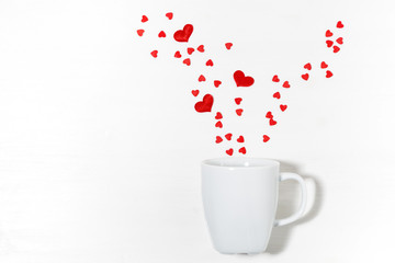 sugar hearts and white cup, concept photo for Valentine's Day