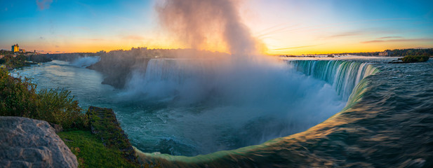 Zelfklevend Fotobehang Groen blauw Sunrise at Niagara Falls. View from the Canadian side