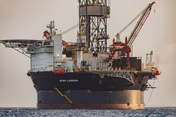"Curacao, Caribbean - April 02, 2014: The oil rig ""Sevan Louisiana"" off the Curacao coast in the Caribbean. Mobile Offshore Drilling Unit (MODU) based on Sevan SSP's Hull Technology.."