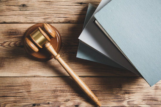 wooden judge on books on the desk