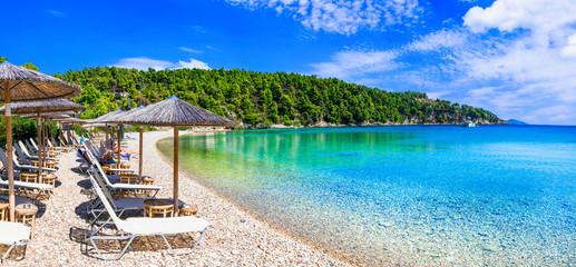 Best beaches of Alonissos island - tranquil organized Milia. Sporades, Greece