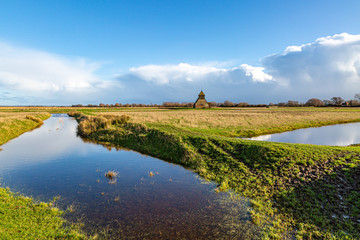 Foto auf Acrylglas Landschaft A view of St Thomas a Becket Church at Fairfield, on Romney Marsh in Kent