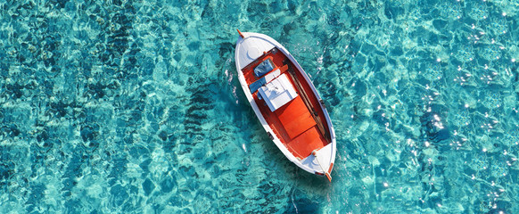 Fototapeta Aerial drone top down ultra wide photo of traditional fishing boat docked in world famous paradise beach of Mykonos island, Cyclades, Greece obraz