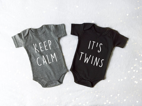 Baby Twin Announcement Bodysuit on a white background with gold hearts - Twin Pregnancy Announcement Design