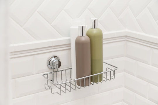 Toiletries bottles on suction cups compact bath shelf, fixing on tiled wall without drilling