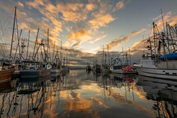 Beautiful sunrise reflection on Comox Fishermans Warf in Comox Valley, British Columbia, Canada Wall mural