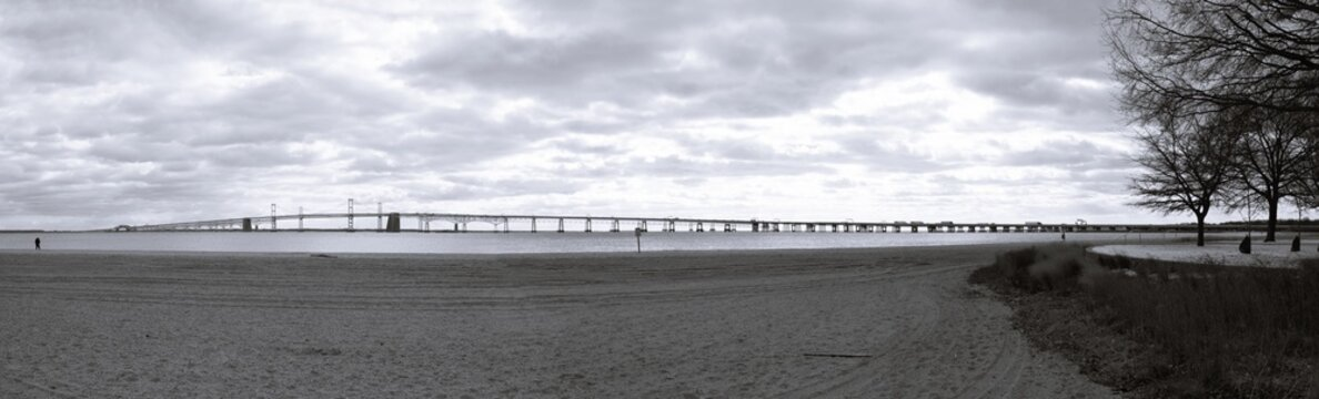 Black and white view of Chesapeake Bay Bridge as seen from the Sandy Point State Park in Maryland USA.