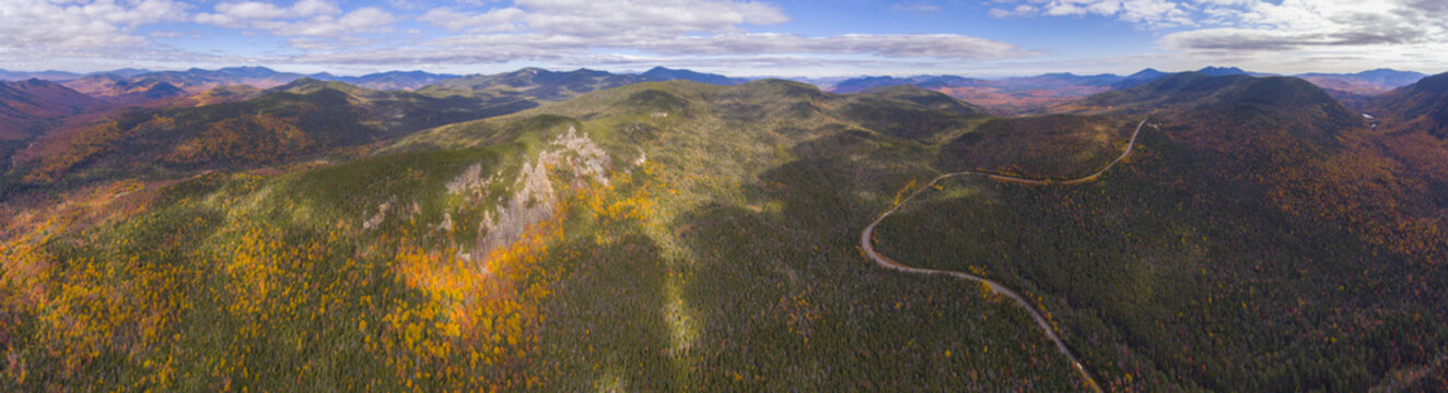White Mountain National Forest fall foliage on Kancamagus Highway near Hancock Notch panorama aerial view, Town of Lincoln, New Hampshire NH, USA.