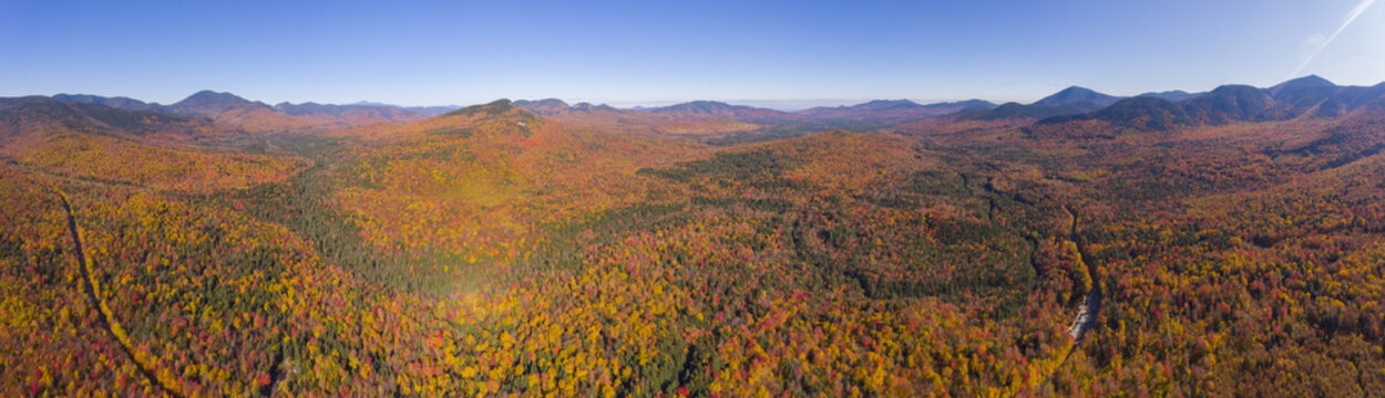 White Mountain National Forest fall foliage on Kancamagus Highway panorama aerial view near Sugar Hill Scenic Vista, Town of Lincoln, New Hampshire NH, USA.