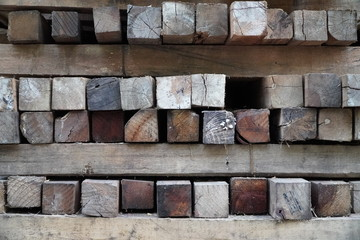 Natural wallpaper, pile of colorful and square wooden posts. Closeup front. Beautiful background, part of a serie.