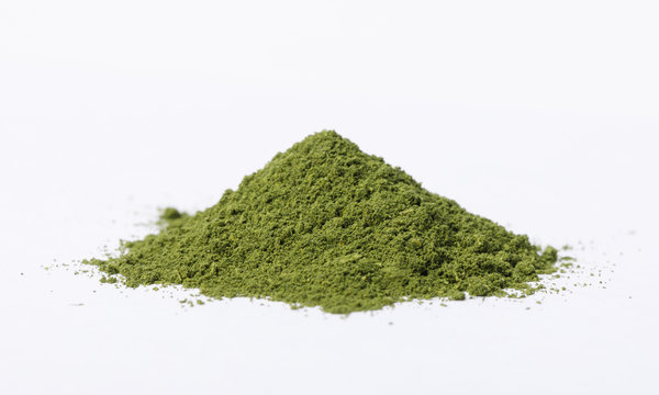 Heap of matcha green tea powder isolated on white background, Organic product from the nature for healthy with traditional style
