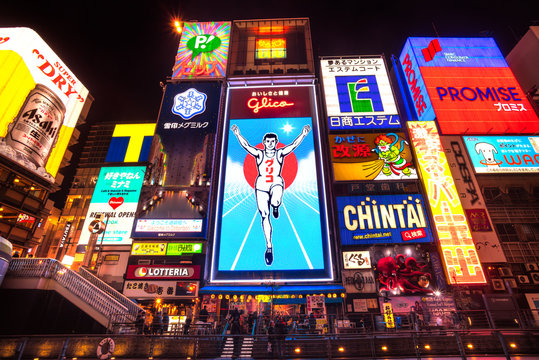 OSAKA, JAPAN - NOVEMBER 24: The Glico Man billboard and other light displays on November 24, 2014 in Dontonbori, Namba Osaka area, Osaka, Japan. Namba is well known as an entertainment area in Osaka.