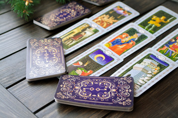 Tarot card interpretation, concept of Christmas divination predictions, close up image