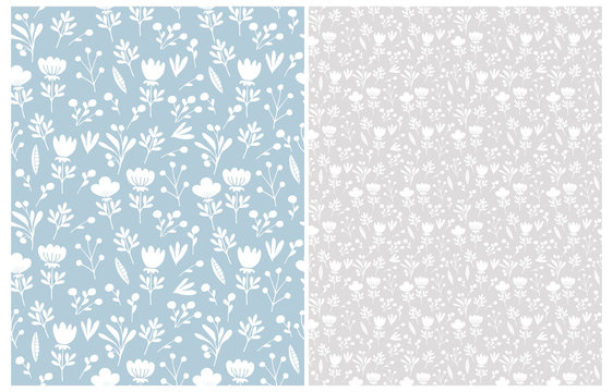 Cute Hand Drawn Floral Seamless Vector Patterns. White Flowers and Twigs Isolated on a Light Blue and Gray Backgrounds. Infantile Style Abstract Garden Design. Pastel Color Floral Repeatable Print.