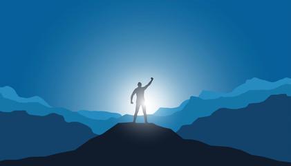 uomo in vetta alla montagna, vincere sfida, raggiungere traguardo Wall mural