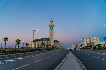 Wall Murals Nasa view of Hassan II Mosque seen from road at sunset - Casablanca, Morocco