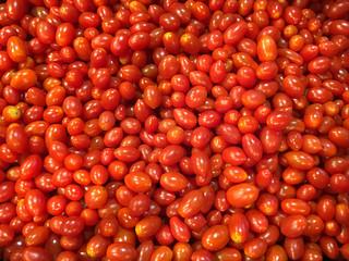 Fresh red cherry tomatoes in supermarket.Fresh cherry tomatoes background texture.
