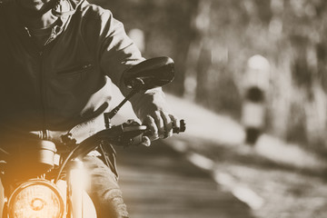 filter and grain photo ; man riding motorbike on a road in freedom lifestyle at vacation time Wall mural