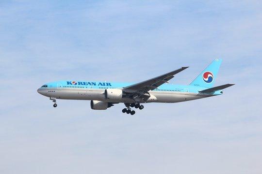 TOKYO, JAPAN - DECEMBER 5, 2016: Korean Air Boeing 777 landing at Narita Airport of Tokyo. The airport is the 2nd busiest airport of Japan (after Haneda).