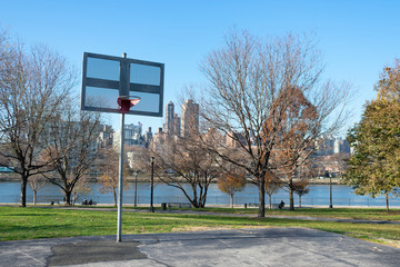 Basketball Hoop at Rainey Park in Astoria Queens New York during Autumn along the East River