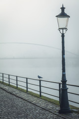 lamp an a foggy river