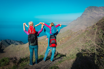 Photo sur Plexiglas Iles Canaries happy mom, dad with kids travel in mountains near sea, family in Canary islands, Spain