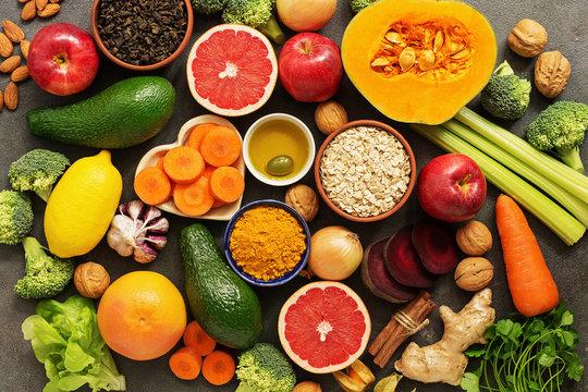 Liver detox diet food concept. Health foods high in antioxidants and fiber. Fruits,vegetables, nuts, olive oil, citrus , green tea, turmeric, oats. Top view, flat lay