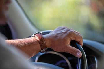 hand on steering wheel Fototapete