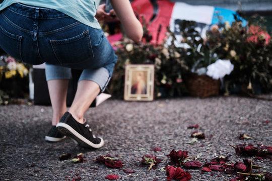 A woman visits the El Paso Walmart shooting memorial