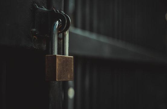 Closeup steel door with lock , padlock , key lock , dark background