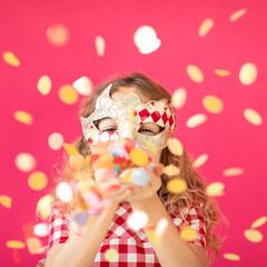 Foto op Textielframe Carnaval Fancy girl blowing confetti against pink bakground