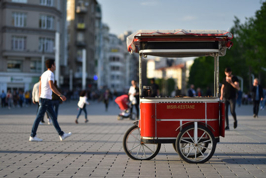 Turkish traditional street food cart on wheels. Text on cart in translating from Turkish language to English is Corn and chestnut.