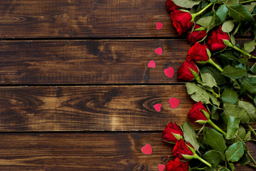 Keuken foto achterwand Roses Red roses on a dark wooden background