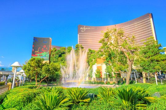 Las Vegas, Nevada, United States - August 18, 2018: Wynn Las Vegas Fountain Show with rainbow in blue sky. The Wynn is Resort Hotel Casino, a 5-star in Las Vegas Strip.
