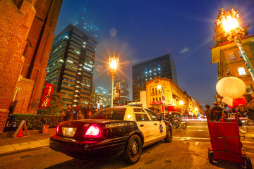 San Francisco, California, United States - August 16, 2016: film crew shooting a fake police car in Chinatown of San Francisco by night. Urban street view.