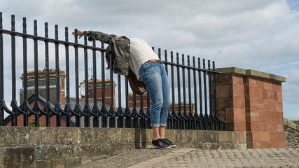 Woman posing on Derry City Walls, Londonderry, Northern Ireland, United Kingdom