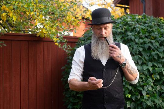 Man with long beard smoking pipe