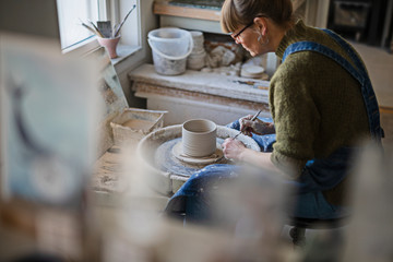 Potter using potters wheel