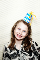 Girl wearing party hat