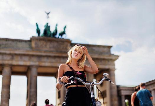 Teenage girl with Brandenburg Gate on background, Berlin, Germany